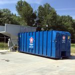Auger-Pak™ EMD-80W, Yard Installation, Right-Feed Hopper, Forklift-Fed, Front View, with Attached Container