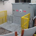 Enclosed Dock Installation, Rear Feed Hopper with a Swing Door, Hand-Fed