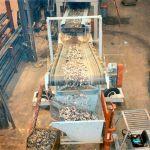 Horizontal Steel Belt Conveyor Feeding a Rubber Trough Stacking Conveyor