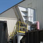 Quad-Shaft Electromechanical Shear Shredder, Auger-Pak™ EM-15G, installed outside view of service platform and hopper